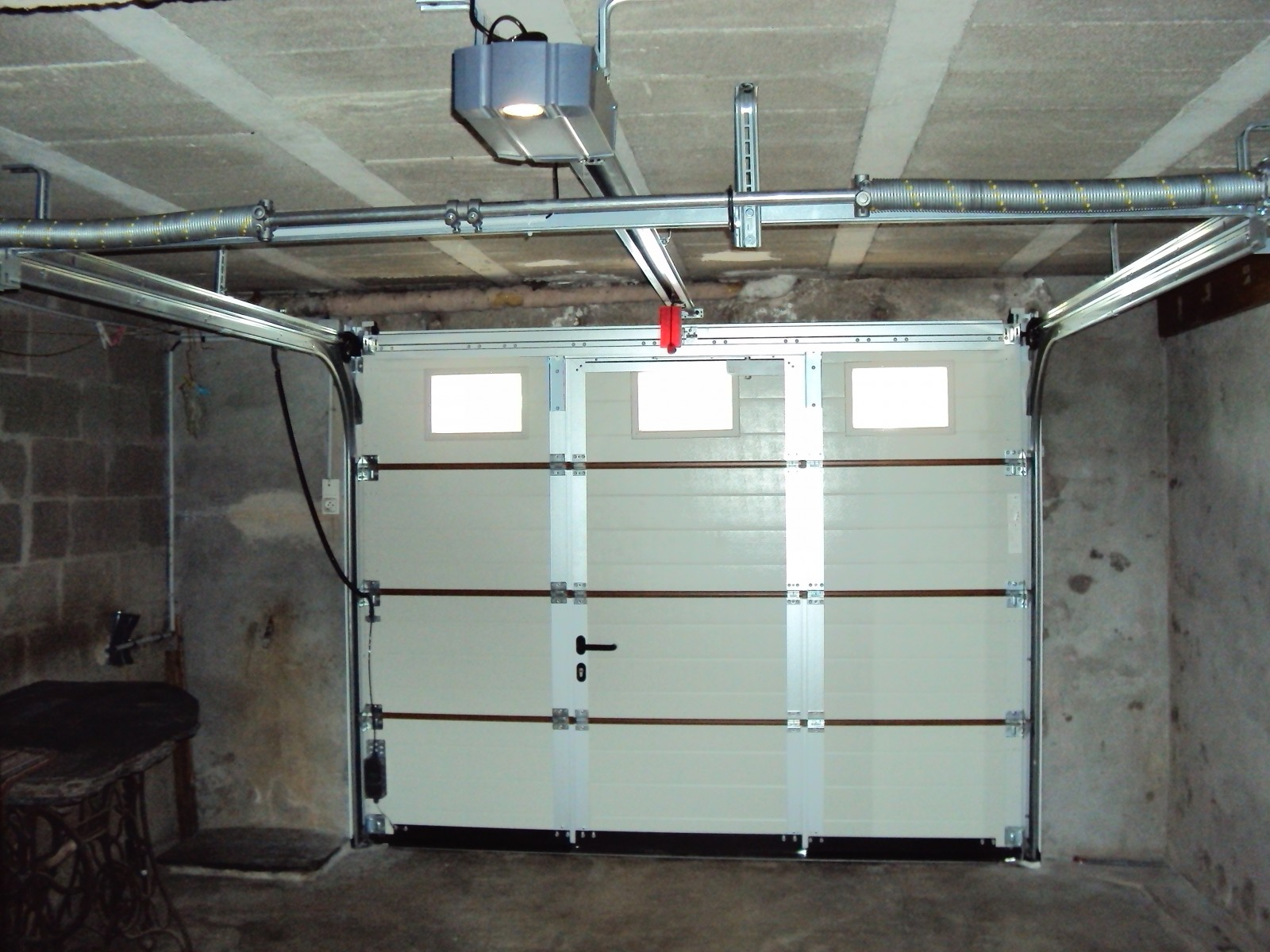Motorisation porte de garage for Verin pour porte de garage basculante