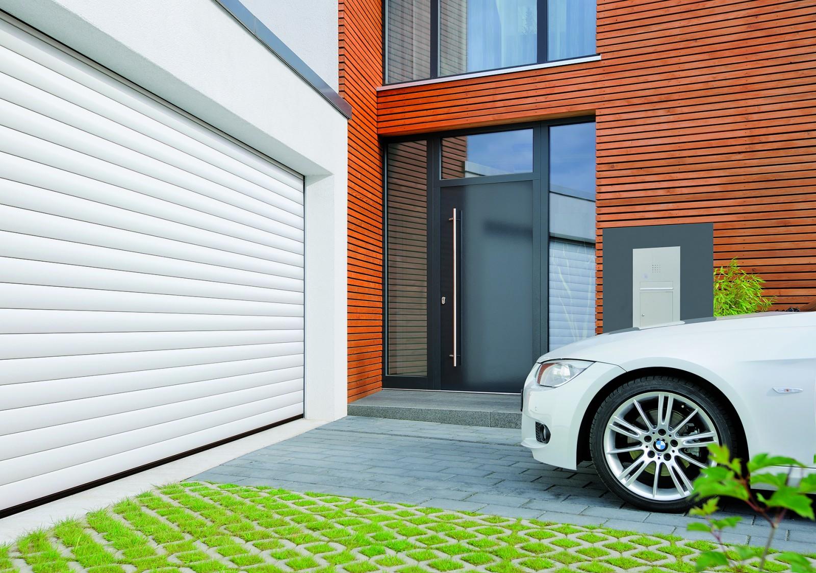 Porte garage enroulable motoris e for Portail garage enroulement