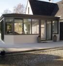 extension à toit plat en aluminium et avec muret